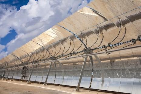 Row of solar panels in desert area