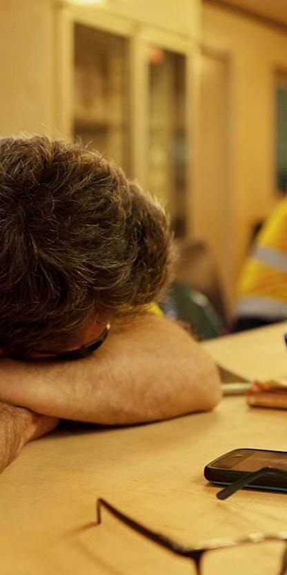 Tired miner resting in break room