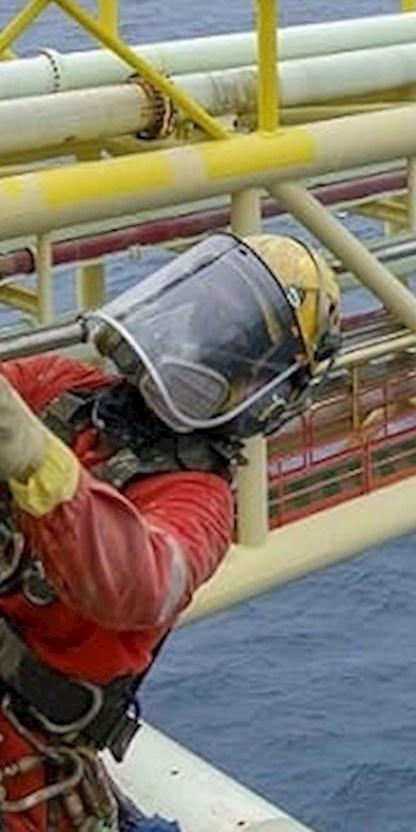 Worker on oil rig banner