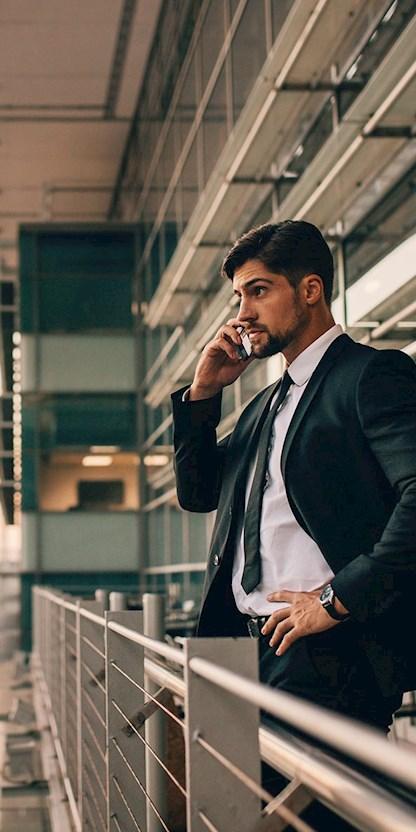 Businessman using phone at airport