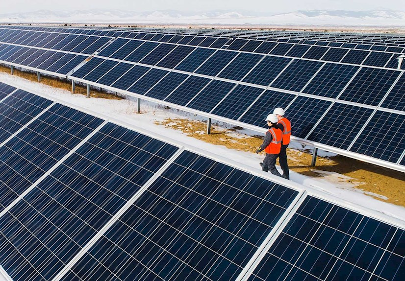 Workers inspecting solar panels