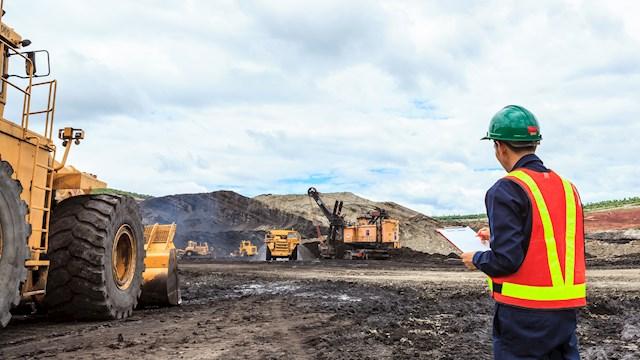 worker in open pit mine