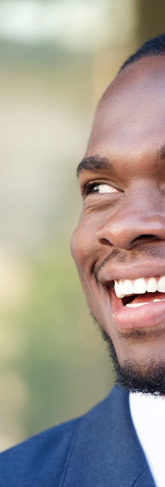 Brazilian candidate smiling after landing job