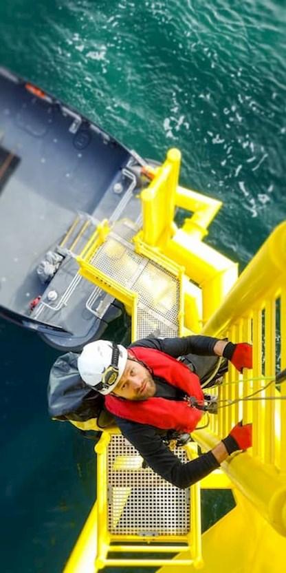 Man climbing ladder offshore
