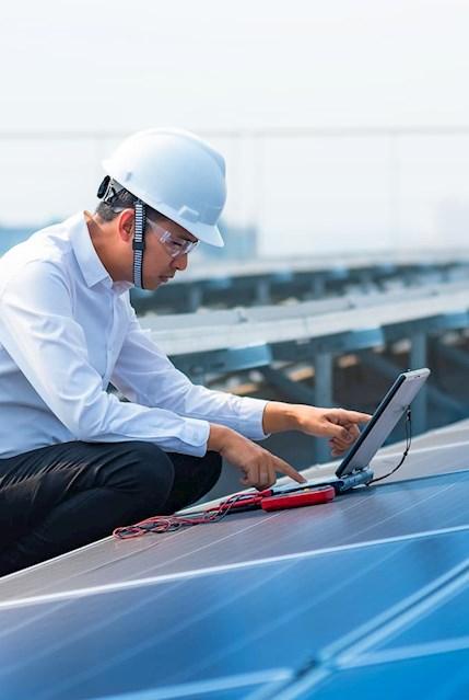 Employee working on solar panel